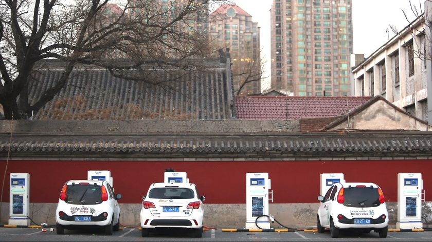 Electric rent-a-cars recharge at a recharging station in Beijing, China