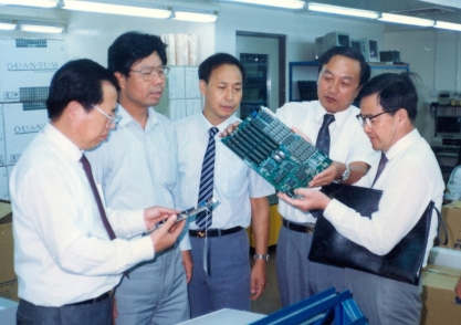 Liu Chuanzi (second right) at work with colleagues in 1989.